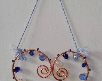 Handmade hanging heart decoration with copper wire and blue glass beads