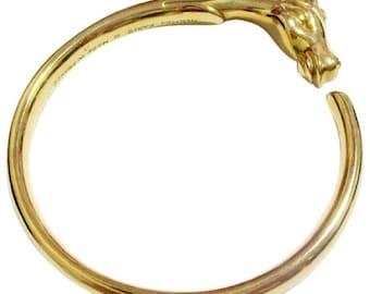 Vintage Hermes golden horse head design bangle, bracelet. Beautiful classic jewelry from Hermes.