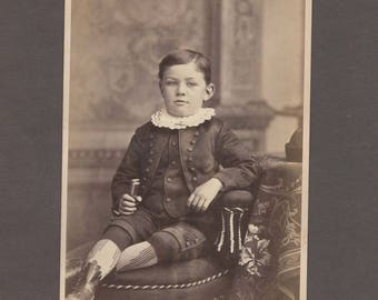Cabinet Card of a Beautifully Dressed Boy with a Harmonica