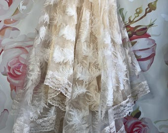 ivory embroidered feathers handkerchief hem boho wedding dress by mermaid miss kristin