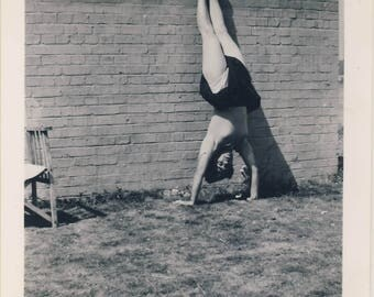 Young woman doing a handstand, Vintage photograph c1930s
