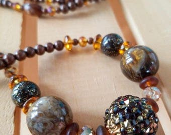 long brown and gold beaded necklace