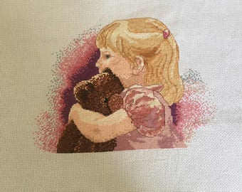 Little girl and teddy bear completed cross stitch