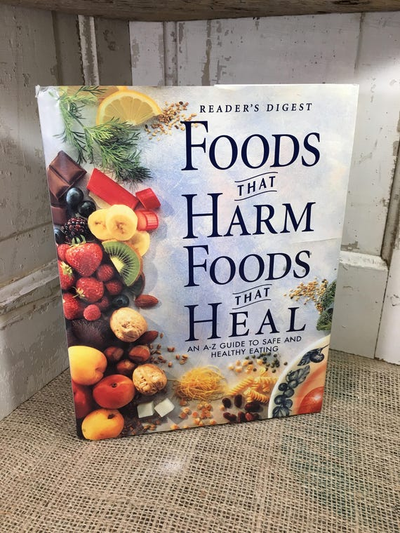 Readers Digest Foods That Harm Food That Heal copyright 1997, large hard cover with dust jacket, An A-Z guide to safe and healthy eating