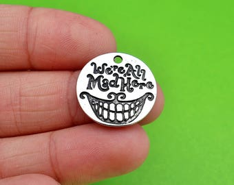 "5 ""We're All Mad Here"" Alice in Wonderland Charms (CH304)"