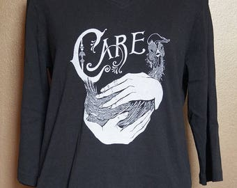 """XL """"Care"""" Long Sleeved Tee, White Ink on Black"""