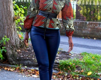 African Print in an aztec print top/blouse/jacket with faux leather belt