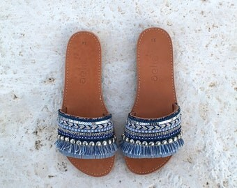 woman leather sandals with blue decorate