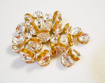 Rhinestone spacers. Yellow Topaz crystal spacer beads. Silver plated rondelle spacer beads. 8 mm round spacers. Destash. Jewelry Supplies