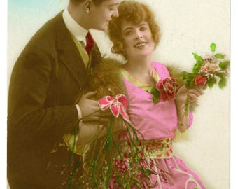 French 1920s vintage Christmas / New Year postcard, loving couple, pink dress, mistletoe, Bonne Annee, old hand tinted Furia greetings card