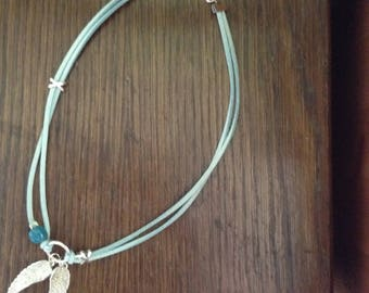 Rock turquoise suede and silver charms necklace