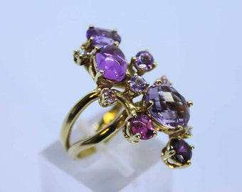18 Kt yellow gold ring with pink tourmalines, amethysts and Diamonds