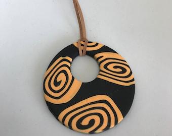Tribal Influenced Circular Pendant - Orange and Black on adjustable leather strap
