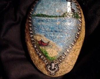 Looking through an unzipped beach stone at a serene scene