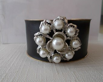 Black and Gold Tone Cuff Bracelet with a Silver Tone and White Sea Shell Pearl Center