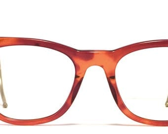 Vintage eyewear. Made in England. 1950's. Cool Amber color frame with silver temples. Very good quality and condition! Hipster Urban Men!