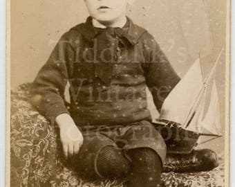 CDV Carte de Visite Photo Victorian Cute Young Boy, Child, Model Boat Yacht Toy Portrait - South Kensington Studio London England - Antique