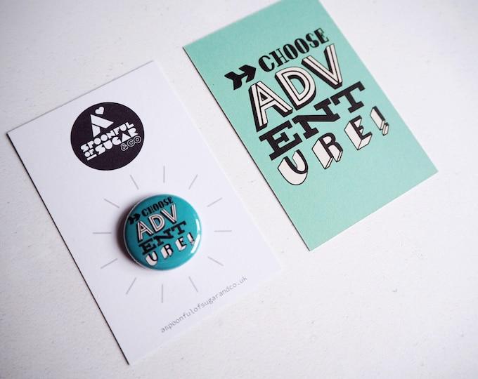 Choose adventure! Hand drawn typographic badge (blue)