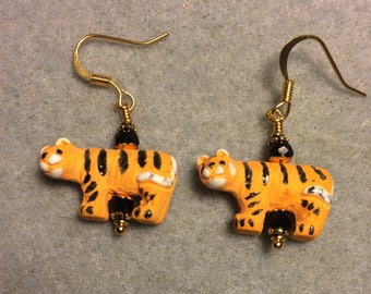 Small orange striped ceramic tiger bead earrings adorned with black Chinese crystal beads.
