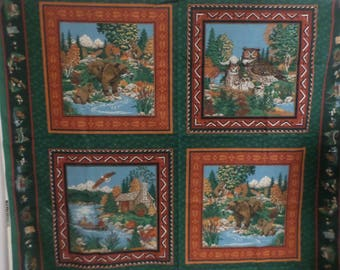 Concord Fabrics by Joan Kessler from 1993 4 fabric panels an owl  bears log cabin and men canoeing each panel is 15 1/2 by 15 1/2 inches.