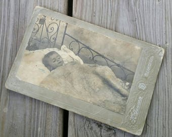 Antique cabinet card post mortem child under the covers
