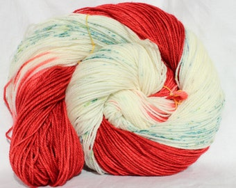 RTS Hand dyed yarn, Red / green / cream, speckled yarn, Christmas yarn, variegated yarn, worsted weight yarn, superwash wool 100g