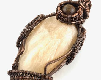 Stilbite gemstone pendant with Pietersite, wire wrapped in copper.  Creating A Dimensional Doorway To Other Worlds