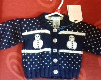 Hand knitted Christmas themed cardigan to fit a child aged 0-3 months old