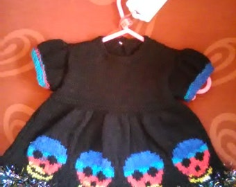 Hand knitted Skull themed dress to fit a baby girl aged 0-3 months old