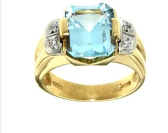 18 Carat ring with topaz