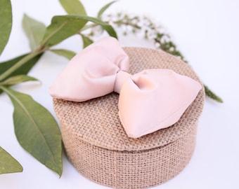 Ring pillow in Burlap, pastel pink silk bow.