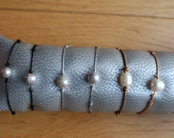 light gray or white pearls on leather or nylon cord