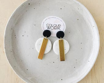 Circle Stick Earrings - Jet Black & White Granite with a brass rectangular bar.