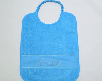 Embroidered turquoise blue baby bib.