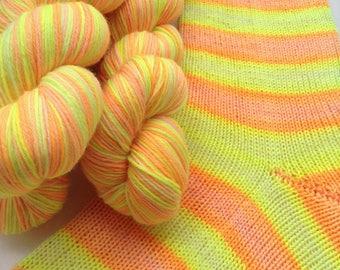 Hand dyed self striping merino sock yarn - Citrus Punch