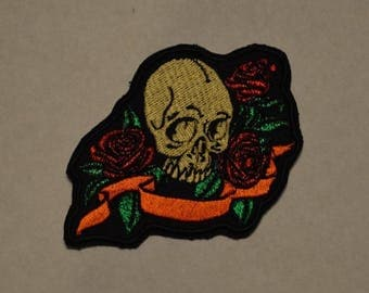 Black embroidered patch with skull