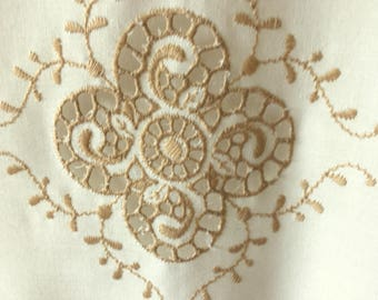 Lovely romantic curtains similar to english embroidery in beige, and bone white bottom.