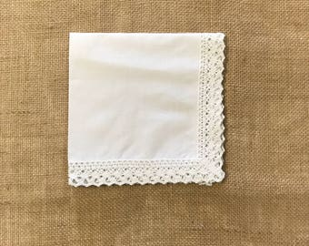 Handkerchief with a beautiful lace trimmed edge.