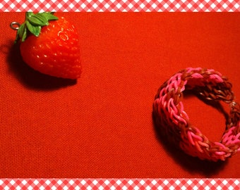 A large elastic bracelet hearts pink and dark red / copper