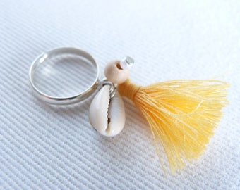 Ring was wooden beads, pastel yellow tassels Sun, pearls and shells