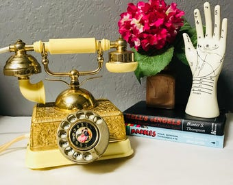antique style rotary phone emobossed gold body midcentury