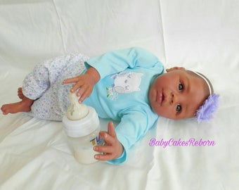 Reborn baby girl Kyra. Ethnic, African American, biracial. Realistic, weighted collectors doll.