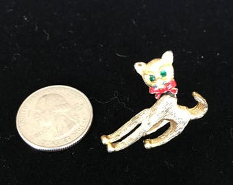 Vintage Goldtone Small Kitty Brooch. Emerald Green Eyes and Red Bow   Articulated Head