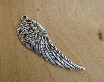 52 mm x 17 mm iridescent rhinestones and silver metal wing pendant.