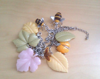 silver coloured charm bracelet with bees, ladybird and fly