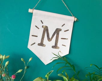 """Wall banner with the magic letter """"M"""""""