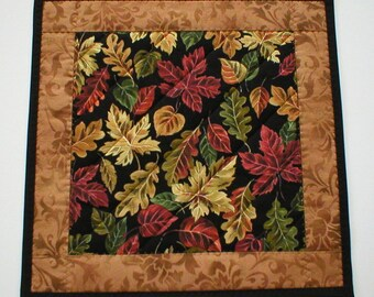 """Handmade Quilted Small Square Table Topper or Candle Mat, Fall Leaves on Black with a Tan Print Border, 14"""" Square (MiniMat2156)"""
