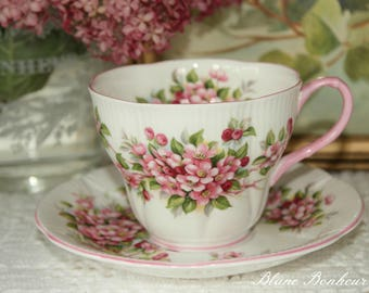 Royal Albert, England: White and pink tea cup and saucer