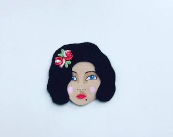 Rita female face brooch