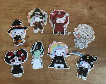 Halloween dress up unicorns. These costume unicorns come in 3 sizes and can be laminated or made into a sticker.